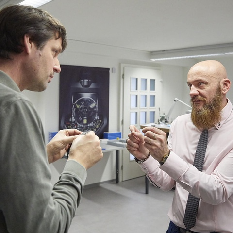 Felix Baumgartner, founder and CEO of the Urwerk brand, talks with Stéphane Violante, Marketing  Project Manager at Starrag Vuadens (right).