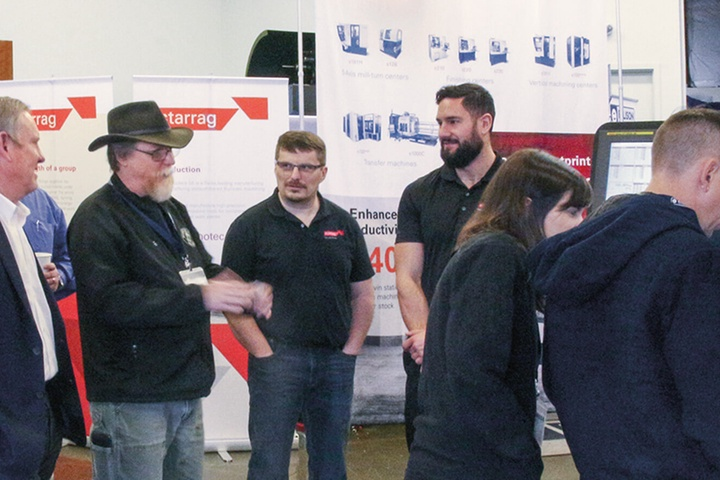 a group of people at a trade fair